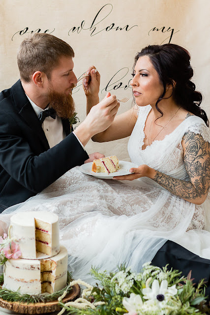 bride and groom with spring wedding cake