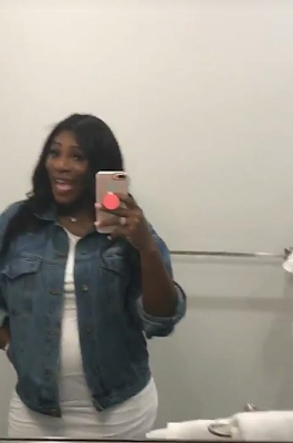 Serena Williams shows off her baby bump in new photos