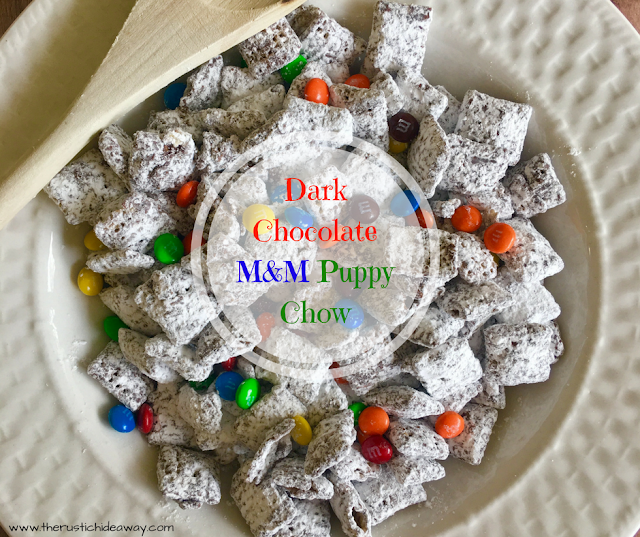 Image of Dark Chocolate M&M Puppy Chow in white bowl