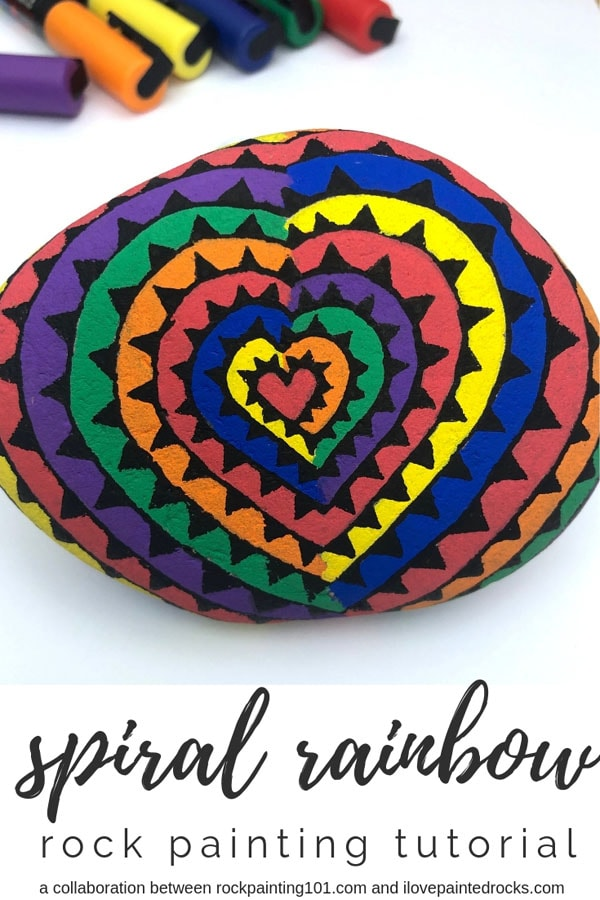 This is such a fun rainbow rock painting tutorial! I love this idea to do a spiral heart rainbow painted rock. These would be fun to hide as part of the kindness rocks or hide and seek rock projects. #ilovepaintedrocks #rockpainting #paintedrocks #rainbow #rainbowrocks #kindnessrocks #hideandseekrocks #paintedstones #stonepainting #easypainting