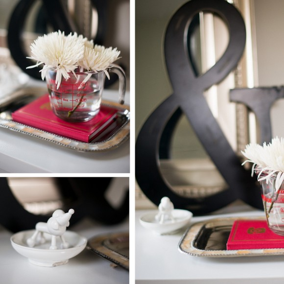 Using a measuring cup as a flower vase adds a whimsical decor element.