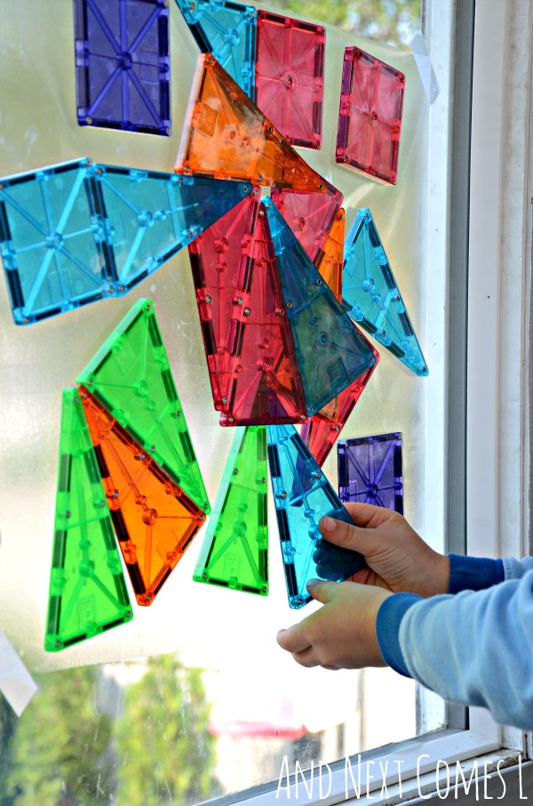 Building with Magna-Tiles on windows from And Next Comes L