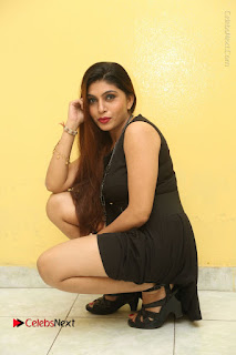 Tollywood Upcoming Actress Pooja Roshan Stills in Black Short Dress at Plus 1 Movie Trailer Launch  0247.JPG