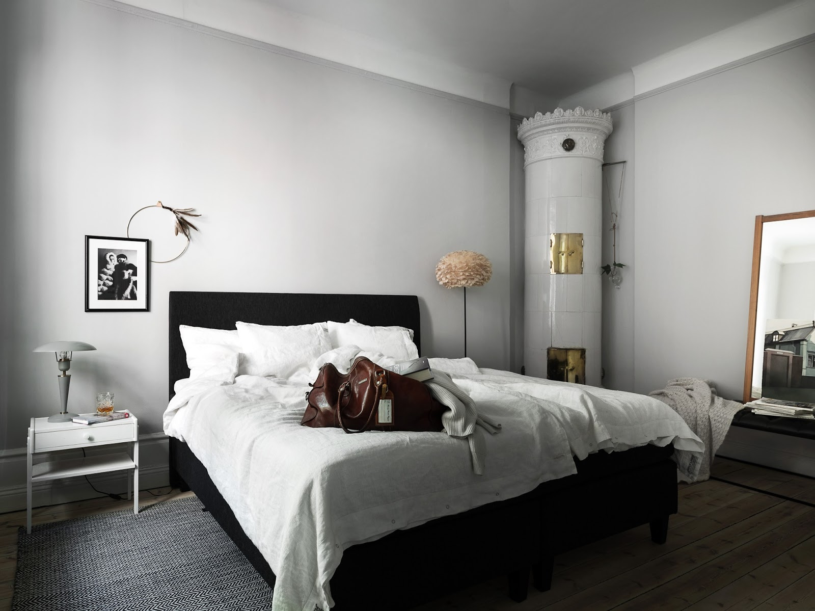 high ceilings apartment with wooden floors, white painted walls, danish design, fireplace, bedroom