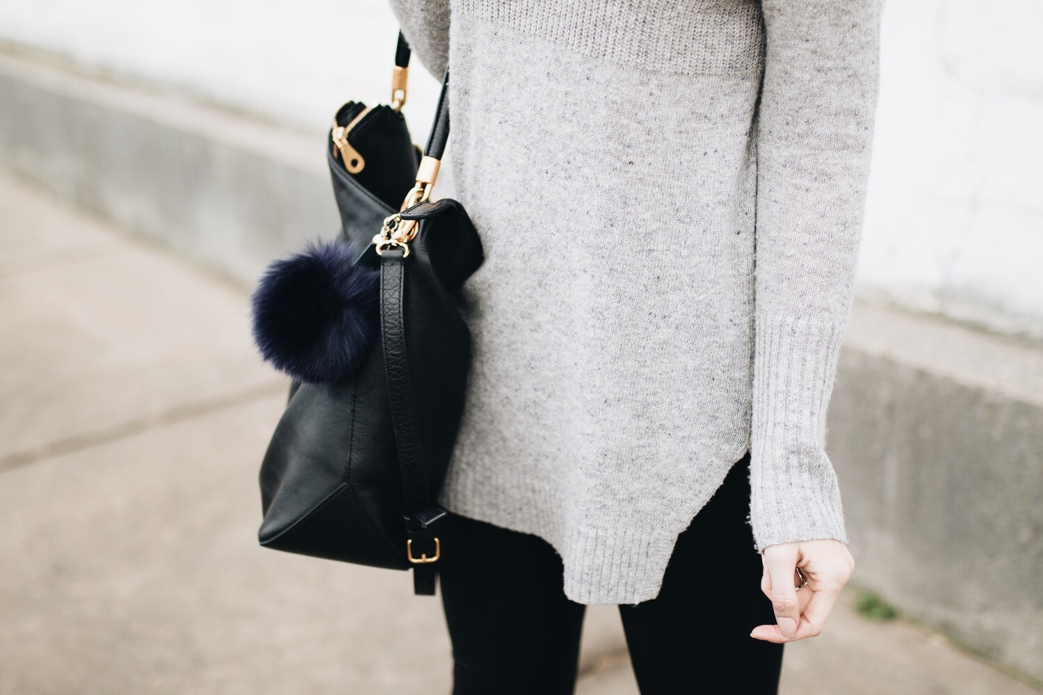 Bag with a fur pom key chain