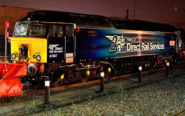 Night photo of diesel locomotive Class 57307 'Lady Penelope' stable for the night on sidings at Rugby station 2016