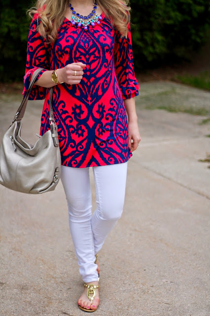 red navy tunic, white jeans, gold bag, gold sandals, statement necklace