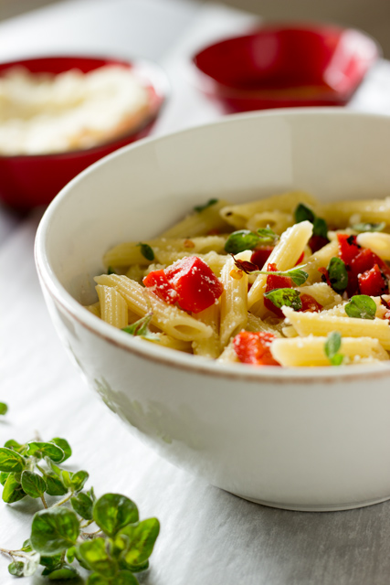 Penne Pasta, Roasted Red Peppers and Fresh Oregano in a Bowl