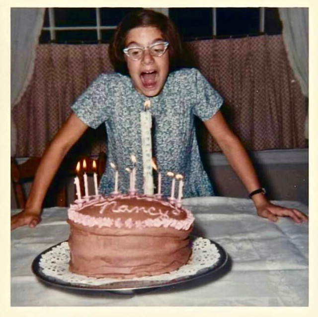 - Nancy blows out birthday candles c. 1950s