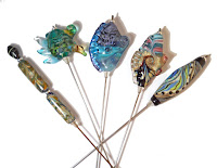 Handmade lampwork glass stick pins from Isinglass Design https://www.etsy.com/shop/glassbead?ref=seller-platform-mcnav&section_id=18945880