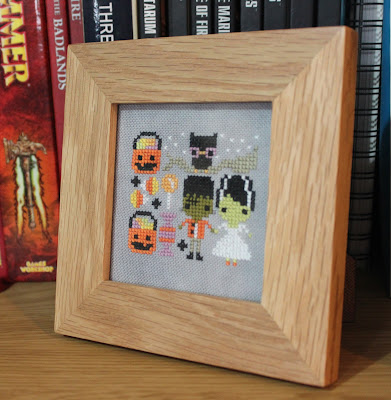 Frosted Pumpkin Stitchery Trick or Treat Couple framed