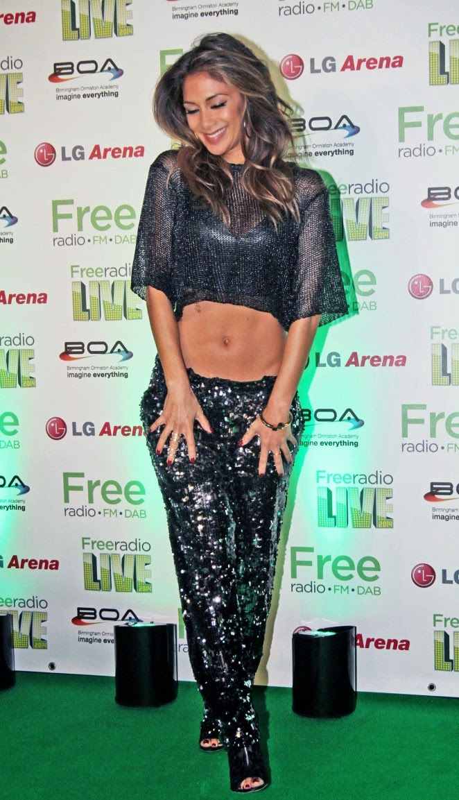 Nicole Scherzinger Shows Off Abs In Cropped Top And