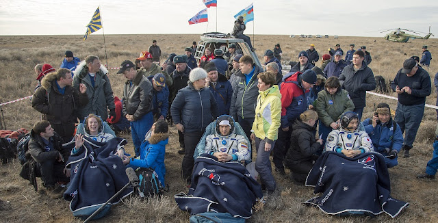 NASA astronaut Kate Rubins, left, Russian cosmonaut Anatoly Ivanishin of Roscosmos, center, and astronaut Takuya Onishi of the Japan Aerospace Exploration Agency (JAXA) sit in chairs outside the Soyuz MS-01 spacecraft a few moments after they landed in a remote area near the town of Zhezkazgan, Kazakhstan on Sunday, Oct. 30, 2016 (Kazakh time).Rubins, Ivanishin, and Onishi are returning after 115 days in space where they served as members of the Expedition 48 and 49 crews onboard the International Space Station. Photo Credit: (NASA/Bill Ingalls)