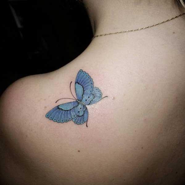 mavi kelebek omuz dövmesi
