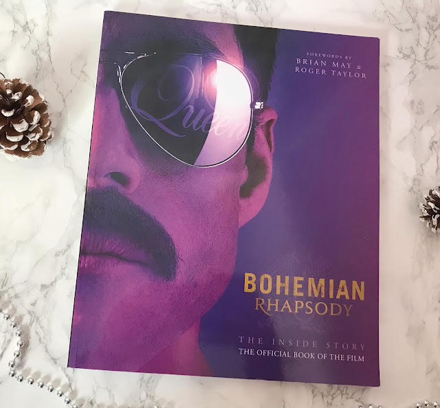 paperback copy of the queen Bohemian Rhapsody film book