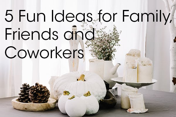 5 fun ideas for family, friends and coworkers picture with white pumpkins, pine cones, white candles, cake stand, white tea pot and flowers