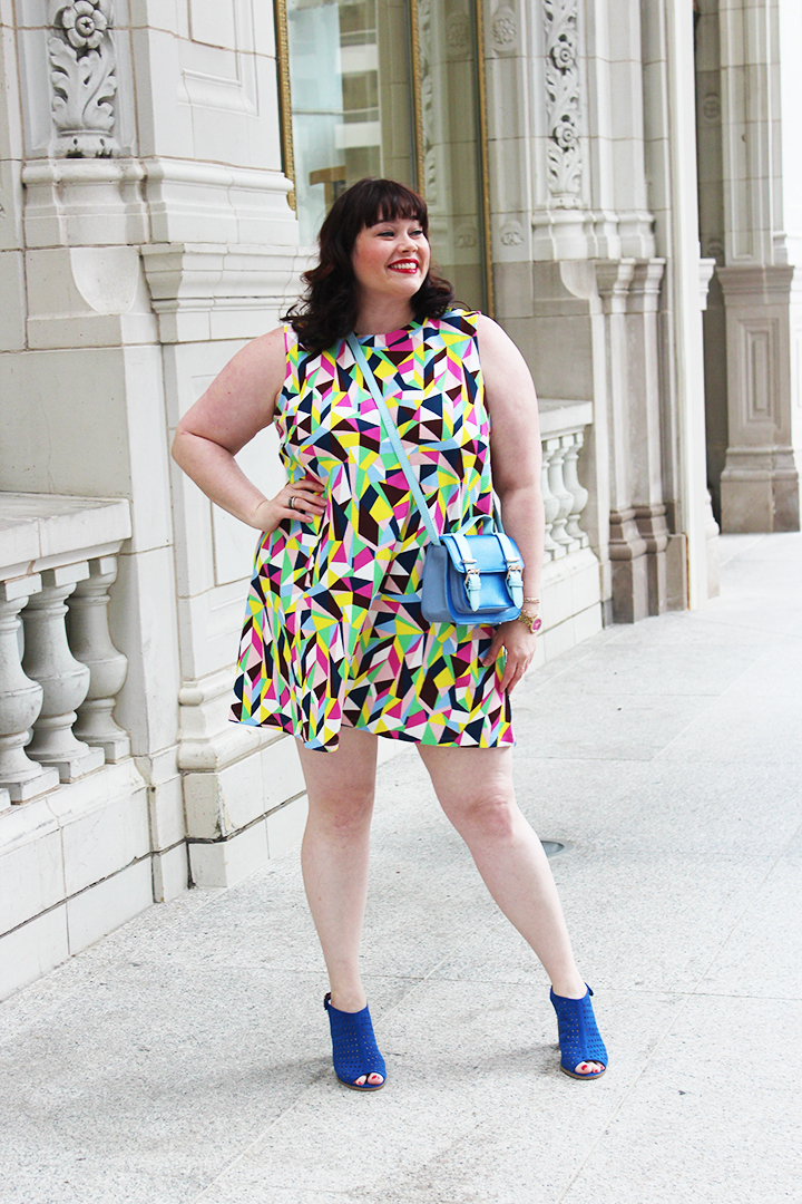 Plus Size Blogger Amber from Style Plus Curves in a Simply Be USA Colorful Abstract Swing Dress and Blue Accessories