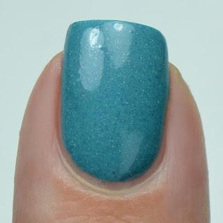 teal nail polish with holo