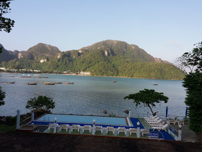 Photo of the view from the dive center at Blue Divers, over the bay and the infinity pool