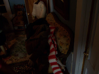 The Settee In The Hall Is Overflowing With Coats And Scarves.