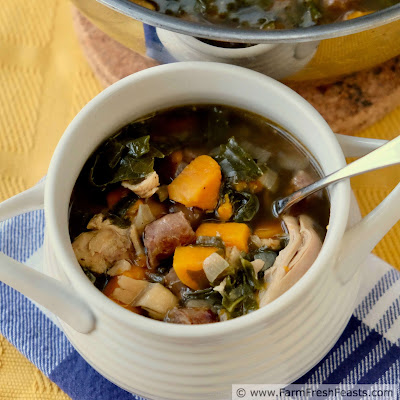 a square image of a bowl of chicken, sweet potato, and kale soup with breakfast sausage