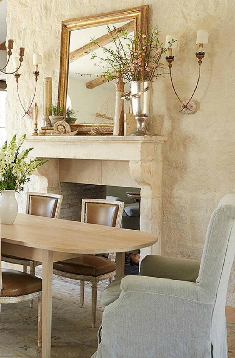 French Country dining room decor! Limestone wall and French fireplace in Patina Farm dining room with modern farmhouse home decor. French Farmhouse Decor Inspiration Ideas will take you on a romantic tour of images capturing this charming decor style. #Frenchfarmhouse #frenchcountry #decorating #interiordesign #romanticdecor #diningroom #giannetti