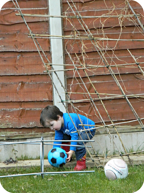 Small boy toddler getting football ball