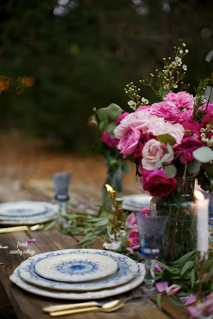 Romantic Valentine's or wedding table setting with blue, white, gold and pink