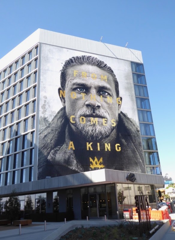 Giant Charlie Hunnam King Arthur movie billboard