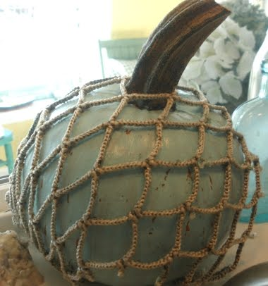 pumpkin decorated with fish net