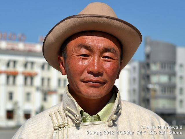 people, portrait, headshot, street portrait, Mongolia, Ulaanbaatar, Chinggis Khaan Square, Mongolian man, traditional Mongolian costume, Mongolian deel