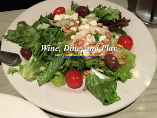 A side salad with hearts of palm, tomato and an Italian vinaigrette at the Bonefish Grill in St Petersburg, Florida