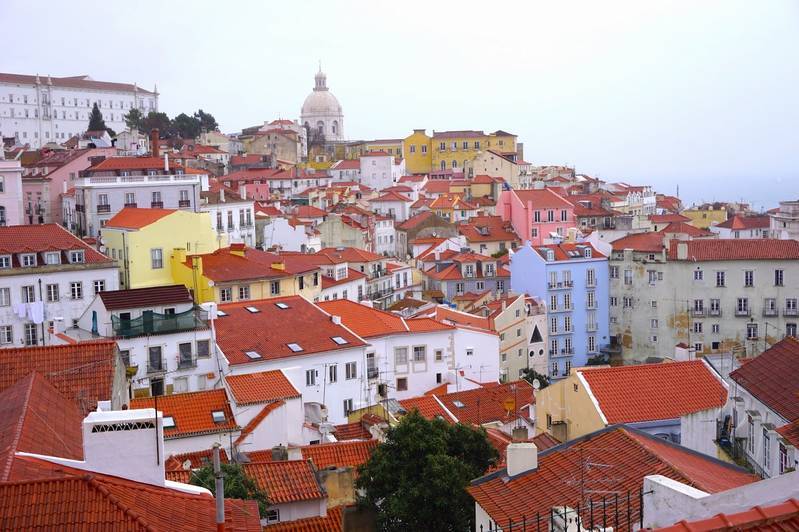 The view from Miradouro Portas do Sol in Lisbon on an overcast rainy day