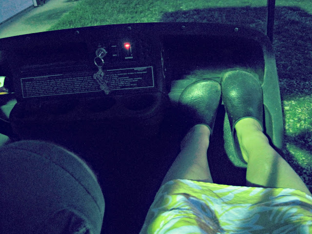 riding in a golf cart at night feet clogs