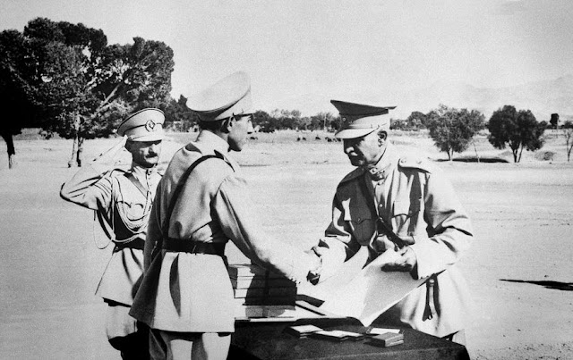Reza Shah Pahlavi hands second son Ali Reza his commission, 19 August 1941 worldwartwo.filminspector.com