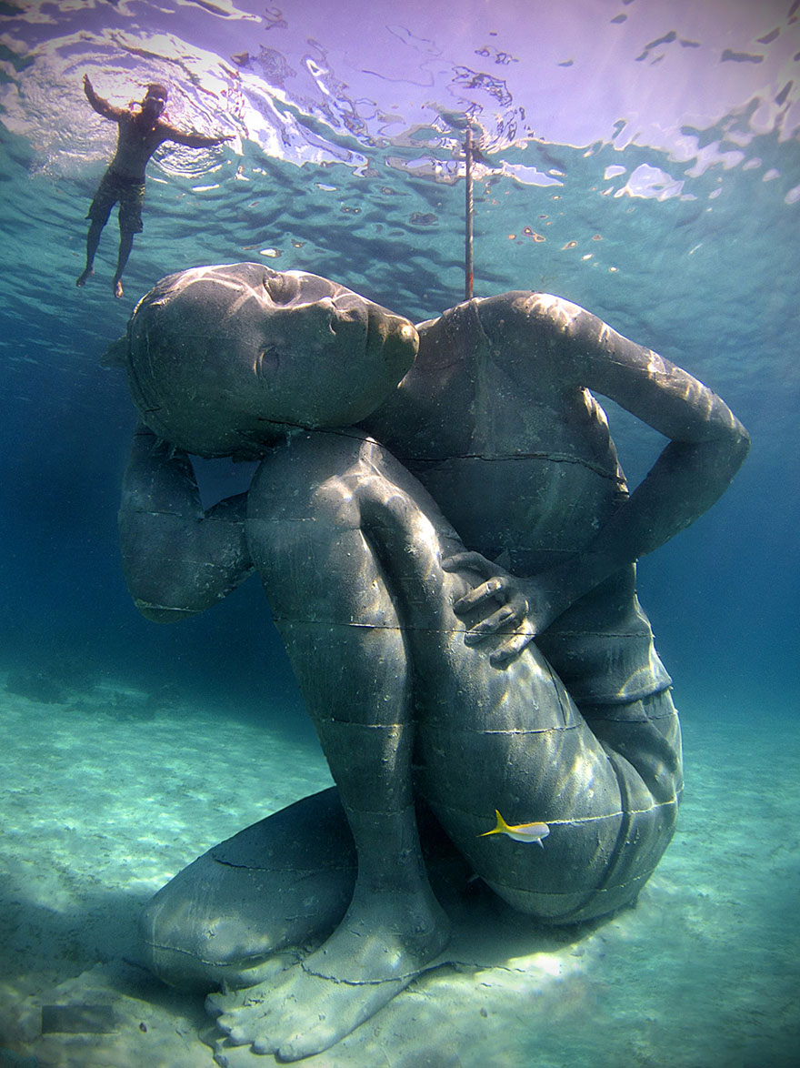 42 Of The Most Beautiful Sculptures In The World - Ocean Atlas: Massive Underwater Statue Of Girl Carrying The Ocean On Her Shoulders