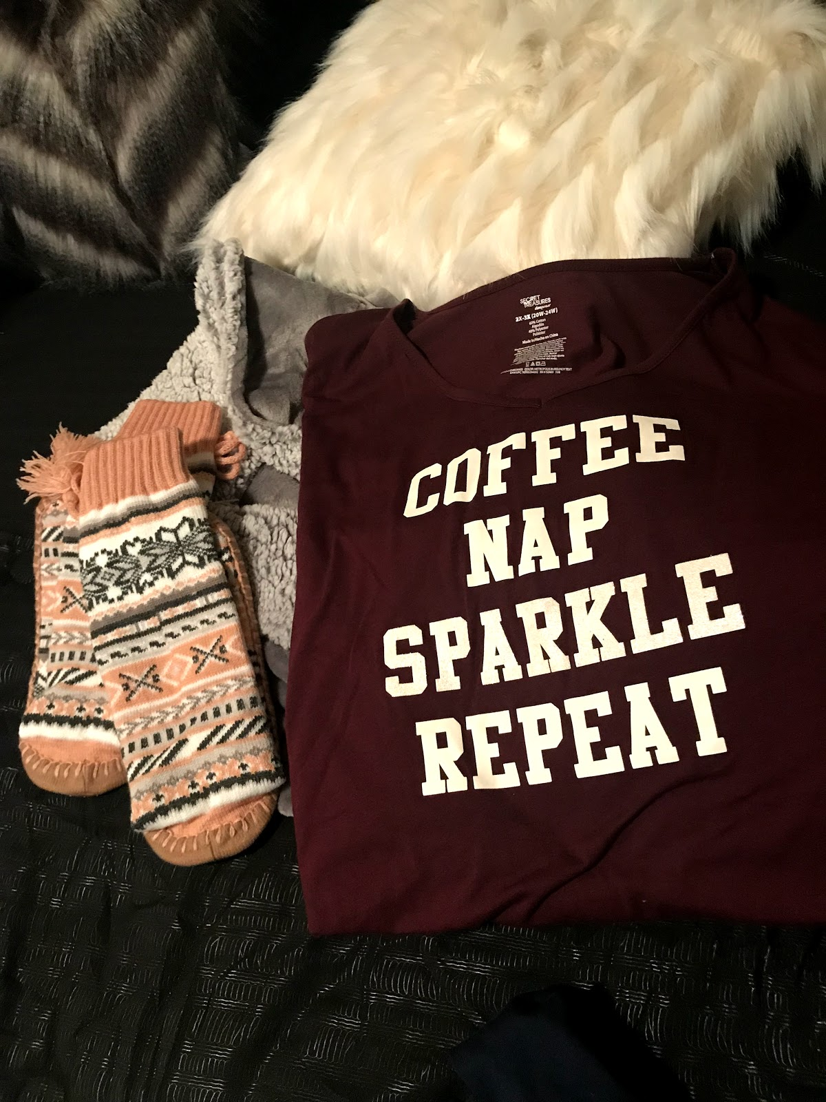 Image: Items being packed for a road trip. Night shirt that reads coffee, nap, sparkle repeat. socks and robe.
