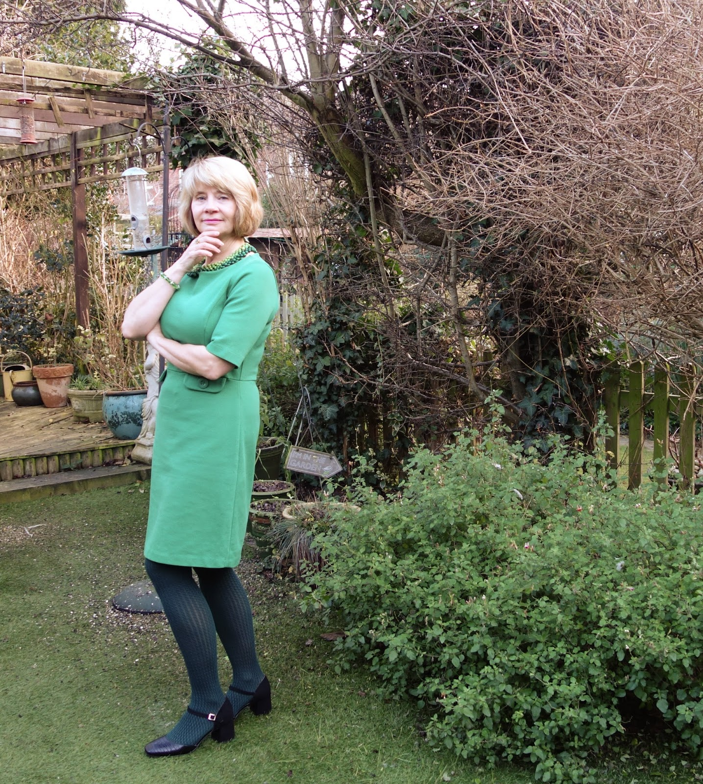 Boden green dress on 40 something woman