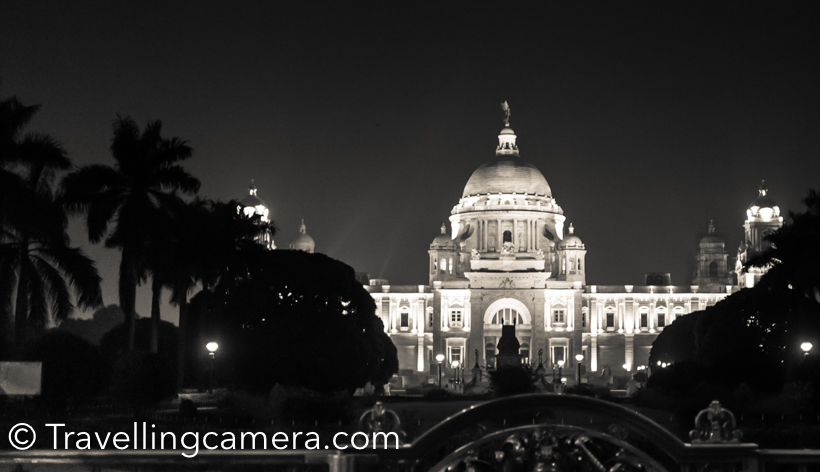 Kolkata has lot of beautiful buildings from british era and Victoria memorial is one of the most beautiful & popular place in the city. During our trip to Kolkata, we visited Victorial memorial twice - once in the morning and once in the evening, when whole building was well lit. This post shares about Victoria Memorial, it's lush green gardens and some of the interesting facts about this beautiful building & other places around.The Victoria Memorial is a huge marble building in Kolkata  (Calcutta) city of West Bengal, India. Victoria Memorialis dedicated to the memory of Queen Victoria  and is now a museum and tourist destination and taken care of by Ministry of Culture. The Memorial is surrounded by grounds around Hooghly river  near Jawaharlal Nehru road.There are multiple gates for Victoria Memorial and the Memorial building is surrounding some water bodies & lush green lawns. We entered into the Victoria Memorial campus through main which is just front of the memorial.We turned towards left just after entering into the Victoria Memorial campus. There is a beautiful water body on the left side of the memorial, which offers great views of Victoria Memorial in water reflection.Different types of birds can be seen around lush green gardens of Victoria Memorial in Kolkata, but Cormorants were in abundance. Most of them were sitting around the edge of water body and it seems that campus has good amount of fish as well.The day we visited Victoria Memorial was being celebrated as National Tourism Day and entry to all monuments was free. Otherwise entry ticket for Victoria Memorial costs 10 rs and ticket for museum is extra,which is priced at 20 rs.Lot of folks come to Victoria Memorial for morning walk or jogging. There are monthly/yearly passes available for folks which cost 100 rs for month and 1000 rs for an year.Victoria Memorial opens at 10am in morning and closes at 5pm. Ticket counter closes at 5pm.  There are lot of maulshree trees around Victoria Memorial, which make the whole environment fragrant. Especially the other side of water body, which is full of trees and plants.These lions sitting on the entry makes the places grander.