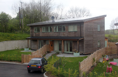 A pair of two-bedroomed semi-detached passive solar houses.