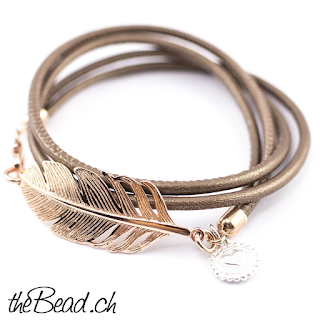 https://www.thebead.ch/product_info.php?info=p177_damen-armband-ros---feder.html