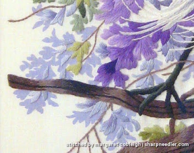 Detail from Elsa Williams' 'Enchanted April' showing printed background and embroidered branch