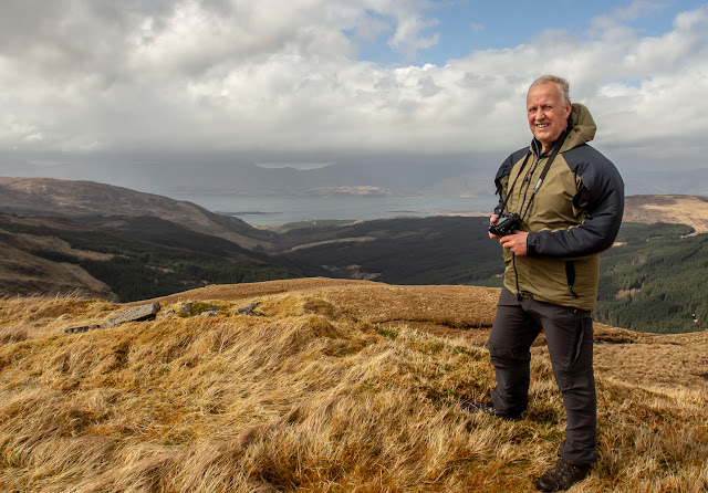 Photo of Phil taking photos on the top of the unnamed Argyll mountain