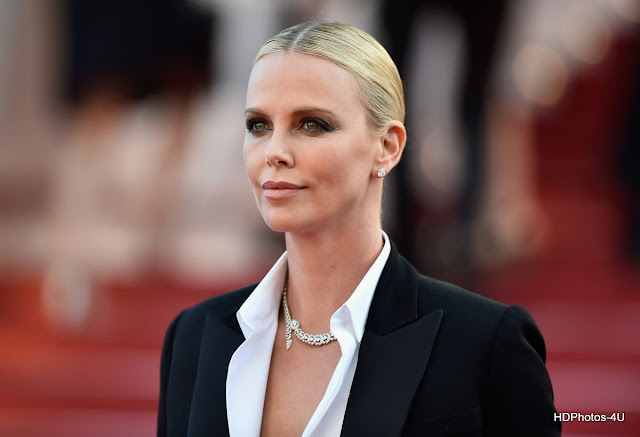 Full HQ Hot & Sexy Photos of Charlize Theron At The Last Face Premiere At 69th Annual Cannes Film Festival