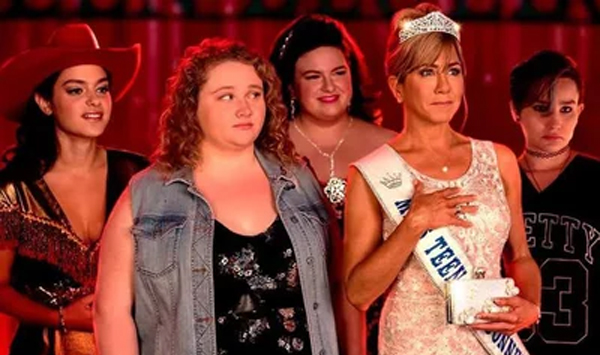 screenshot from Dumplin' of a scene backstage at a beauty pageant, featuring Odeya Rush as Ellen, Danielle Macdonald as Willowdean, Maddie Baillio as Millie, Jennifer Aniston (dressed in pageant gear) as Rosie, and Bex Taylor-Klaus as Hannah