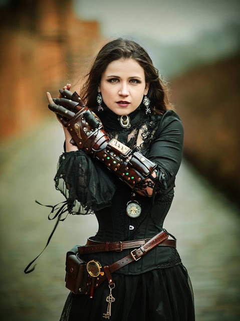 Steamgoth woman wearing gothic steampunk clothing with a leather gauntlet