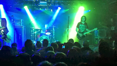 Live show band photo fans metalheads large venue sold out