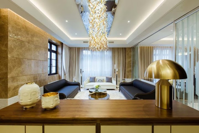 This gold and white chandelier just adds more elegance to this hotel lobby.