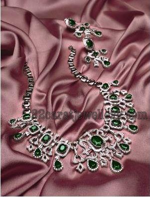 Emerald Studded Tanishq Diamond Sets Jewellery Designs