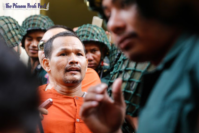 Cambodia National Rescue Party official Meach Sovannara leaves the Phnom Penh Appeal Court yesterday after a hearing. Pha Lina